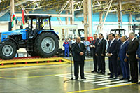 There went from a konveer on the account a 10000-th tractor In the Ganja Automobile Plant.